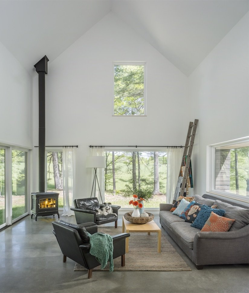 Architect Elizabeth Herrmann's Knoll House project, Best Transitional category winner of 2017 Marvin Architects Challenge.   Tagged: Living Room, Corner Fireplace, Sofa, Chair, Floor Lighting, and Coffee Tables.  Knoll House by Marvin Windows and Doors