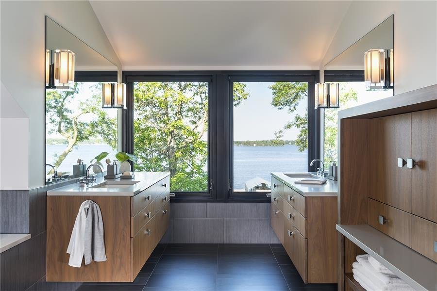 Photo courtesy of Rehkamp Larson Architects provided by Marvin Windows and Doors  Tagged: Bath Room, Engineered Quartz Counter, Undermount Sink, Cement Tile Floor, and Wall Lighting.  Lake Edge by Marvin Windows and Doors