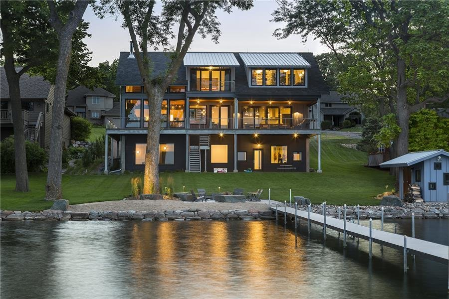 Photo courtesy of Rehkamp Larson Architects provided by Marvin Windows and Doors  Tagged: Outdoor, Back Yard, Large Patio, Porch, Deck, Shrubs, Trees, Hanging Lighting, and Grass.  Lake Edge by Marvin Windows and Doors