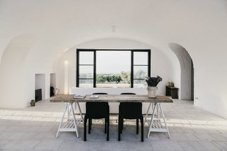 10 Exquisitely Modern Homes in Italy - Photo 2 of 10 - Designed as a modern-day farmhouse, Masseria Moroseta uses local materials, traditional building methods, and details from the local architecture, resulting in a building that fits perfectly within the olive trees, a real Pugliase vernacular. The Masseria is a working farm of organic olive oil, and has six suits with private gardens, for holidays immersed in the countryside, with views to the sea.
