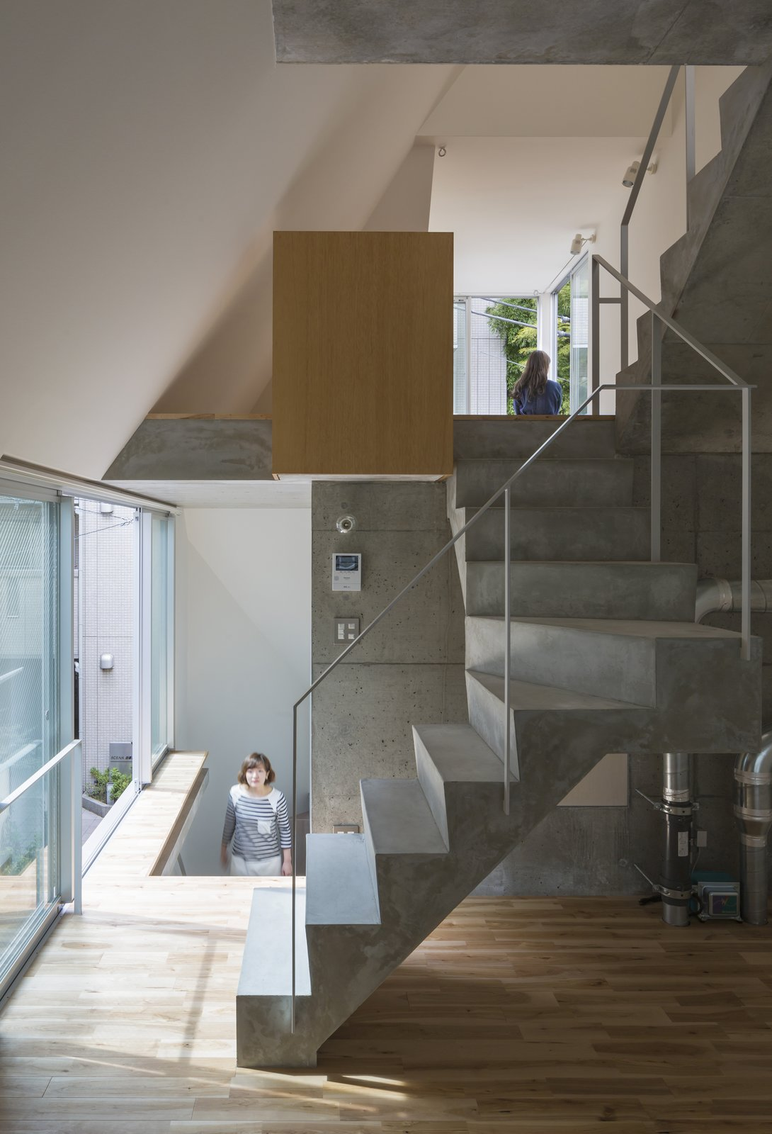 Tagged: Staircase, Concrete Tread, and Metal Railing.  Photo 7 of 10 in Follow Us to 10 Modern Homes in Tokyo from House in Tokyo by Ako Nagao + miCo