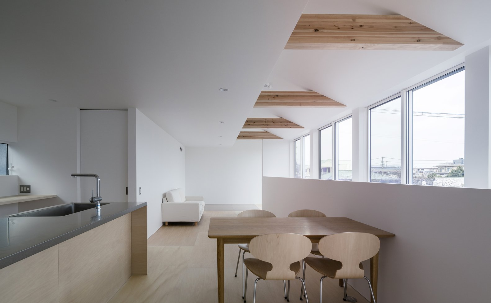 Tagged: Dining Room, Light Hardwood Floor, Chair, Recessed Lighting, and Table.  Photo 3 of 7 in House in Futako by Yabashi Architects & Associates
