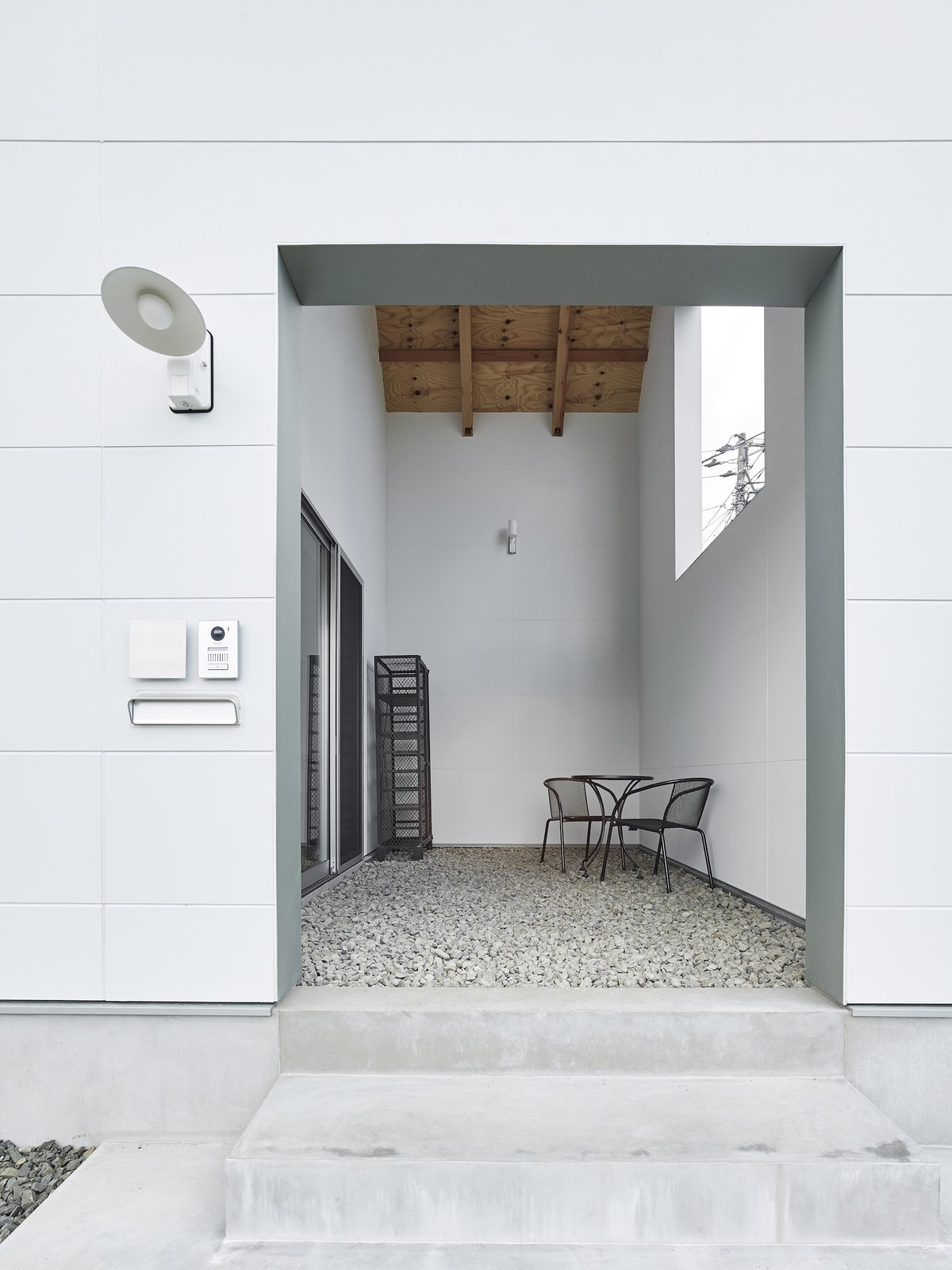 House in Suwamachi is a minimal residence located in Tokyo, Japan, designed by Kazuya Saito Architects.The site is narrower than most, and are sandwiched between two busy roads, as well a railroad tracks. As a result, the architects wanted to limit line of sight, noise, and wind. The result is an interior with high-ceilings in order to open up the space and maintain natural light, as well as an airy entrance area. Tagged: Outdoor, Hardscapes, and Walkways.  Photo 9 of 9 in House in Suwamachi by Kazuya Saito Architects