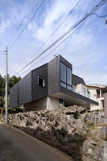10 Ultra-Modern Homes in Japan - Photo 1 of 10 - The lot offers views of Sagami Bay and Enoshima island in the distance.