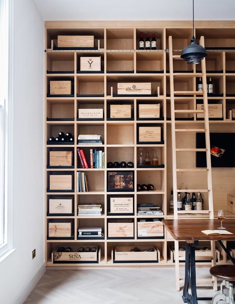 Photo 2 of Wine Collector's Flat by Amos Goldreich Architecture modern home