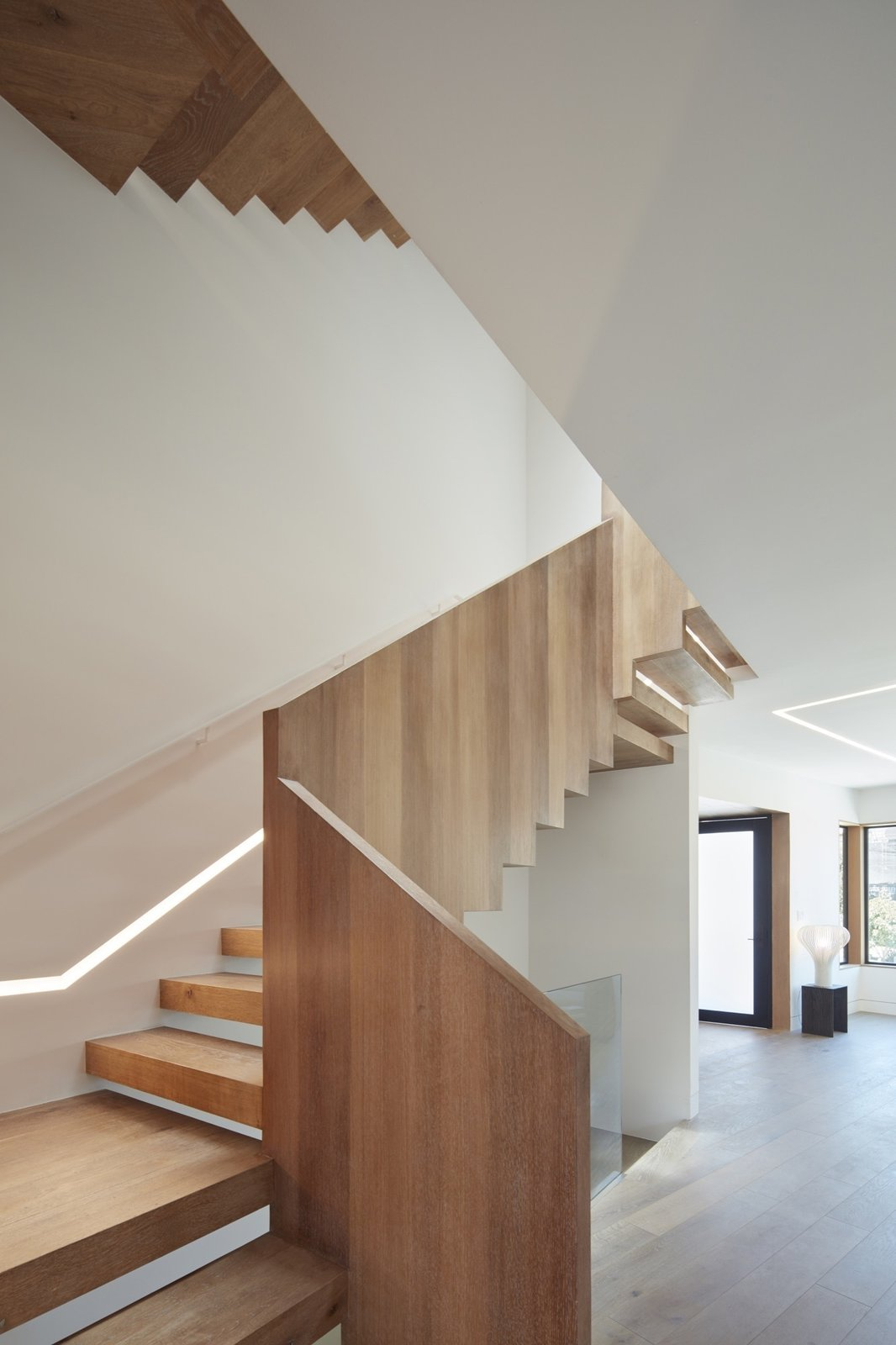 Staircase Tagged: Staircase, Wood Tread, and Wood Railing.  Noe Valley House by Leibal