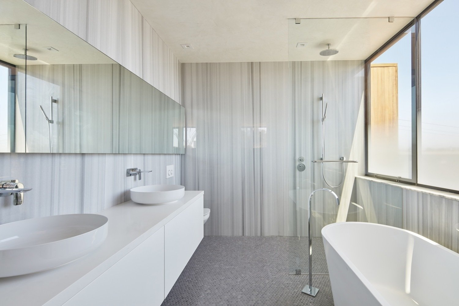 Bathroom Tagged: Bath Room, Engineered Quartz Counter, Ceramic Tile Floor, Vessel Sink, Freestanding Tub, Soaking Tub, and Open Shower.  Noe Valley House by Leibal