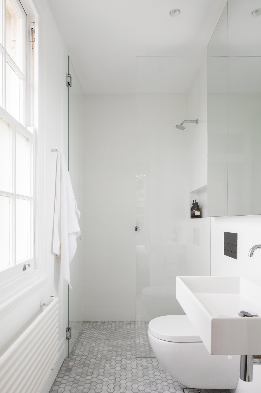Bathroom Tagged: Bath Room, Ceramic Tile Floor, Vessel Sink, Wall Mount Sink, Enclosed Shower, Recessed Lighting, and One Piece Toilet.  K Apartment by Leibal