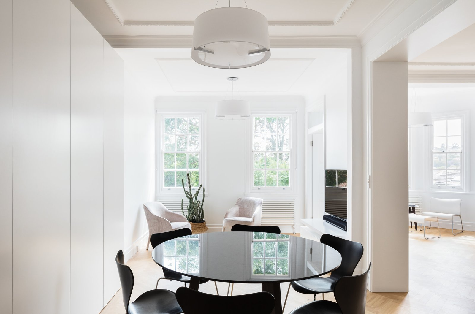Tagged: Dining Room, Chair, Pendant Lighting, Table, and Light Hardwood Floor.  K Apartment by Leibal