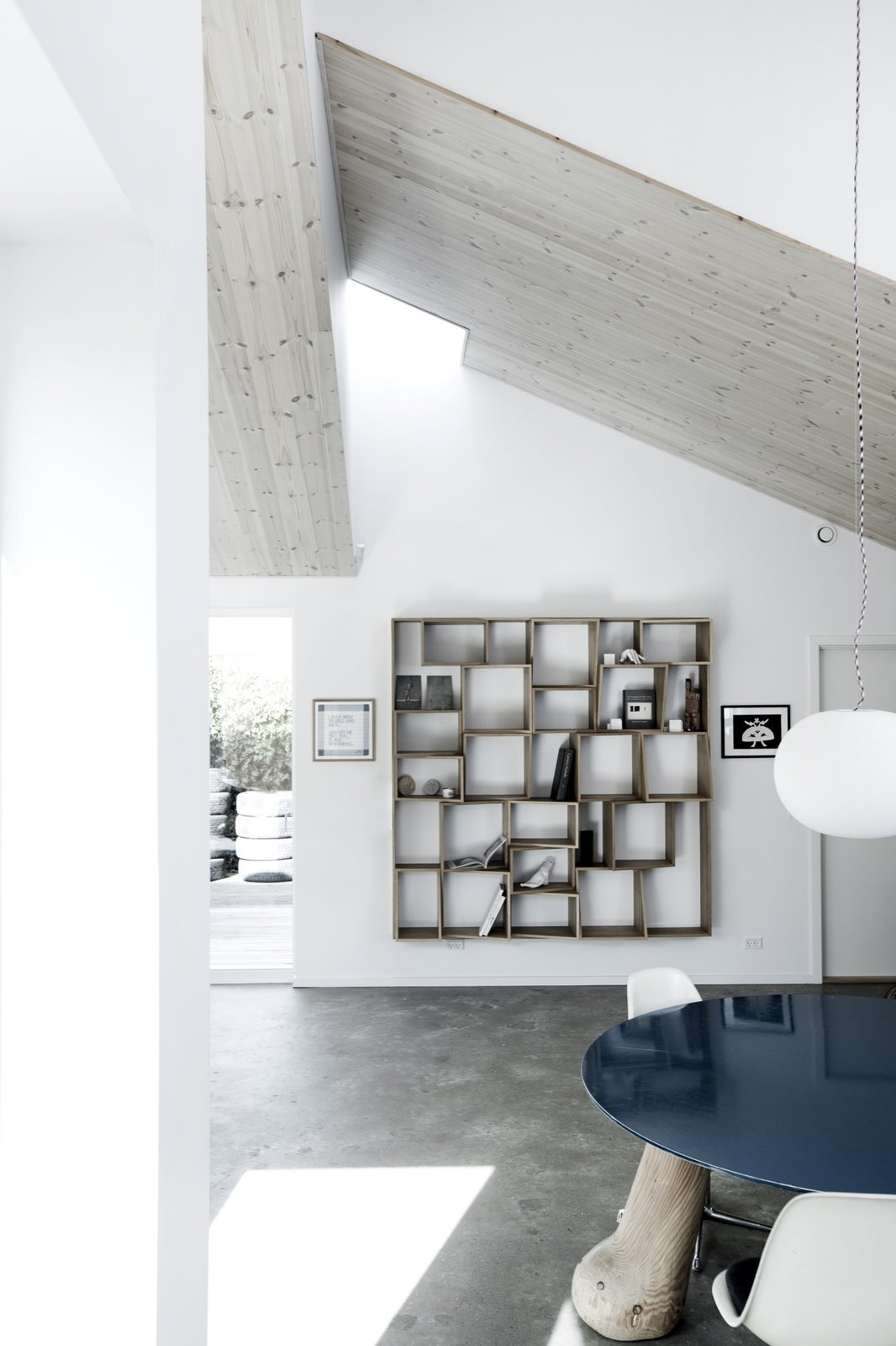Shelving Tagged: Pendant Lighting, Concrete Floor, Shelves, Storage Room, and Shelves Storage Type.  The Roof House by Leibal