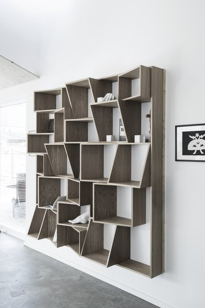 Modern home with living room, bookcase, and shelves. Photo 8 of The Roof House