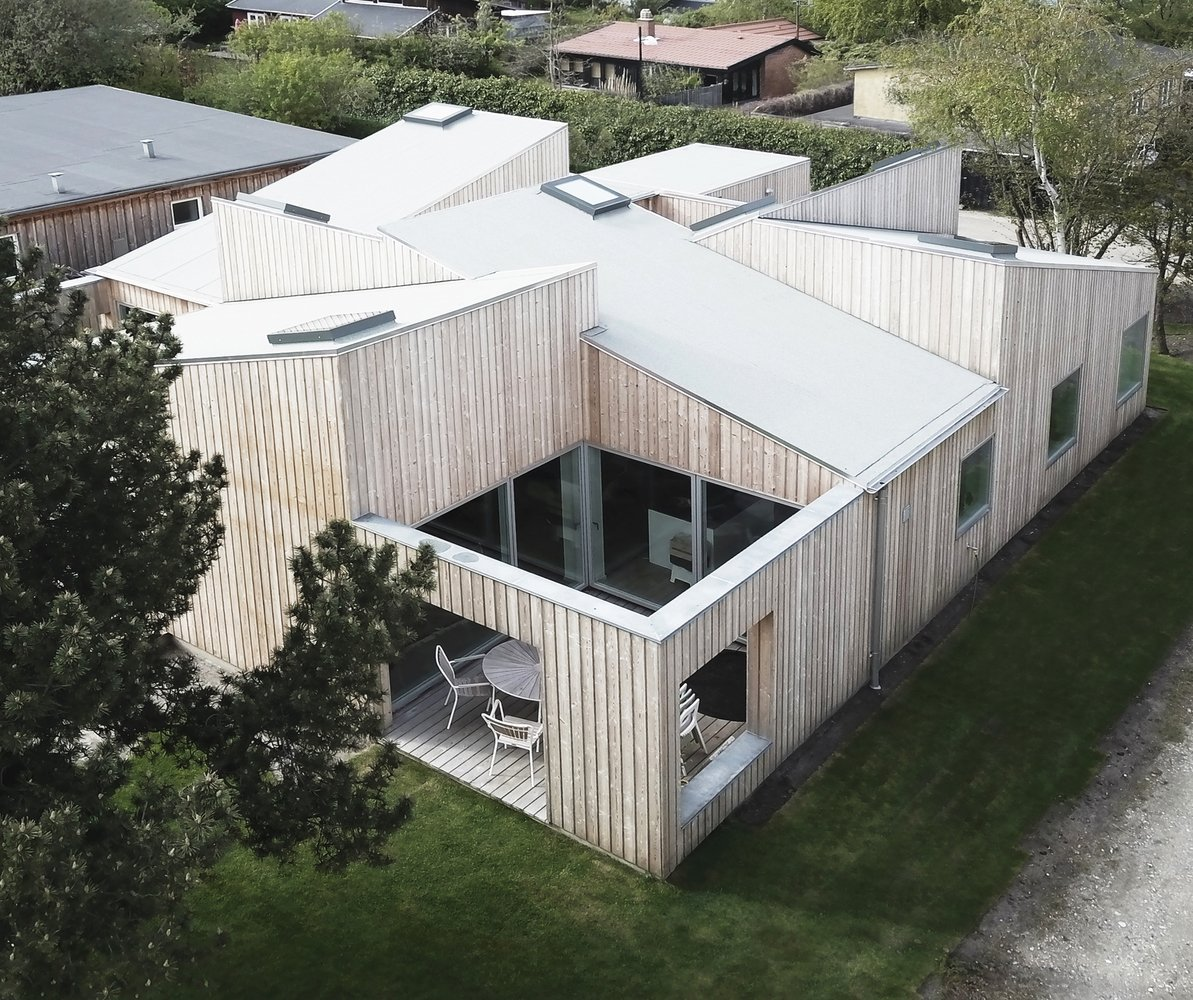 Tagged: Outdoor, Grass, Wood Patio, Porch, Deck, Rooftop, Trees, Small Patio, Porch, Deck, Vertical Fences, Wall, and Wood Fences, Wall.  The Roof House by Leibal