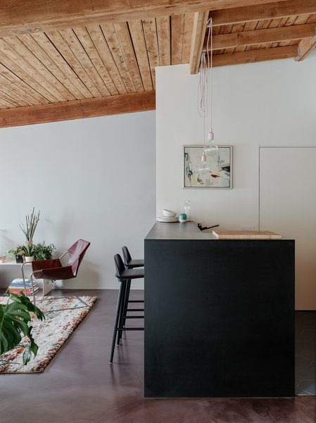 Modern home with chair, concrete floor, and kitchen. Photo 10 of Gowanus Loft