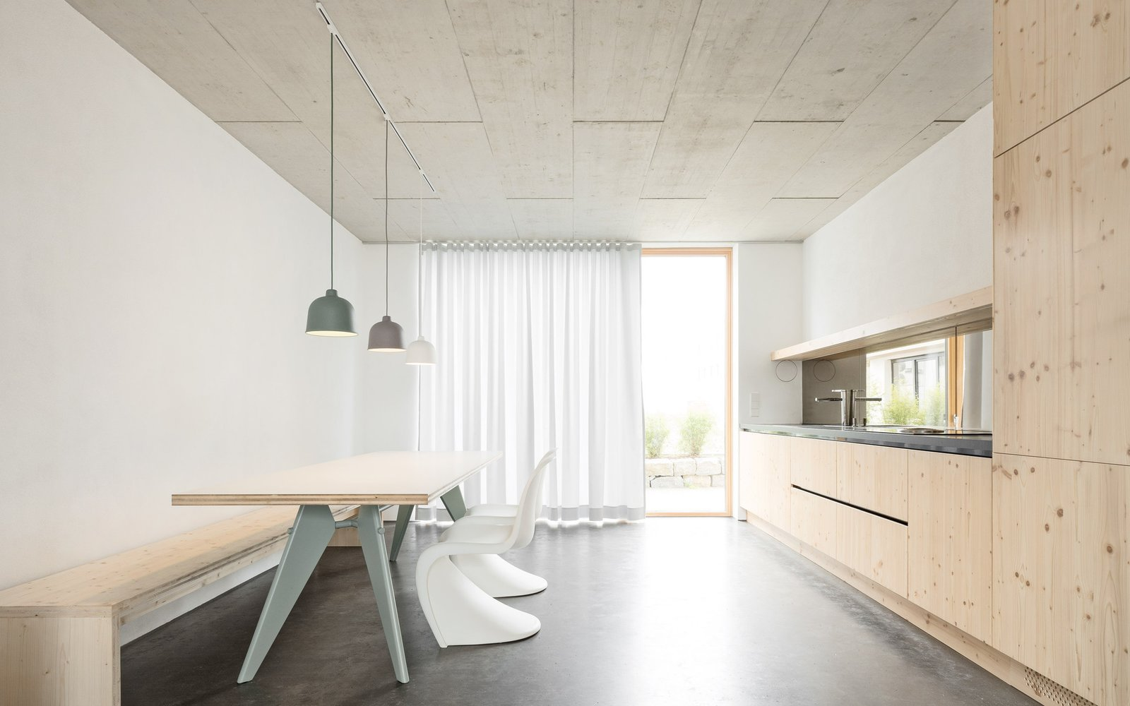 Kitchen Tagged: Kitchen, Concrete Floor, and Pendant Lighting.  Haus B by Leibal