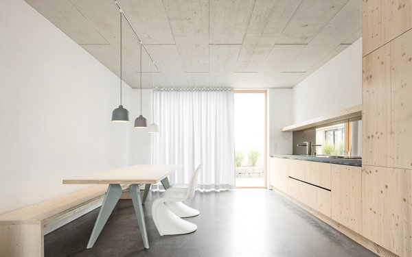 Modern home with kitchen, concrete floor, and pendant lighting. Kitchen Photo  of Haus B