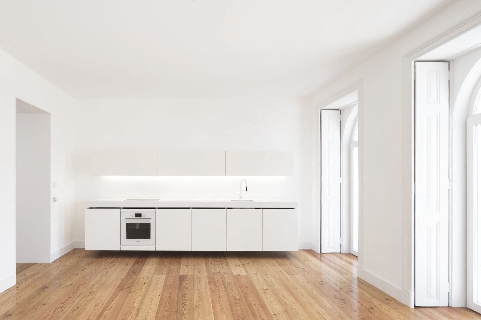 Tagged: Kitchen, Granite Counter, White Cabinet, Medium Hardwood Floor, and Range.  Tap Building by Leibal
