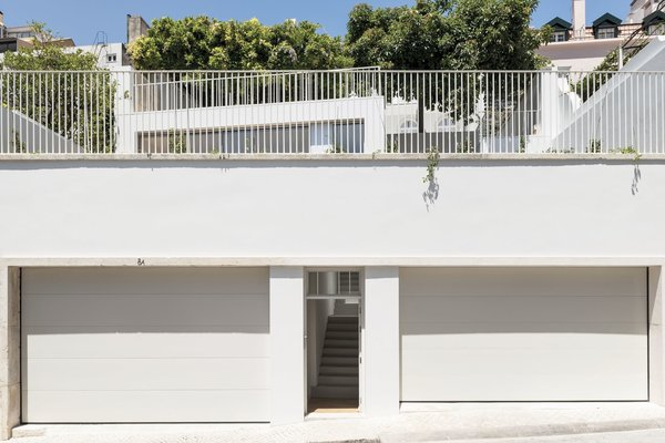 Modern home with garage. Photo 7 of Tap Building