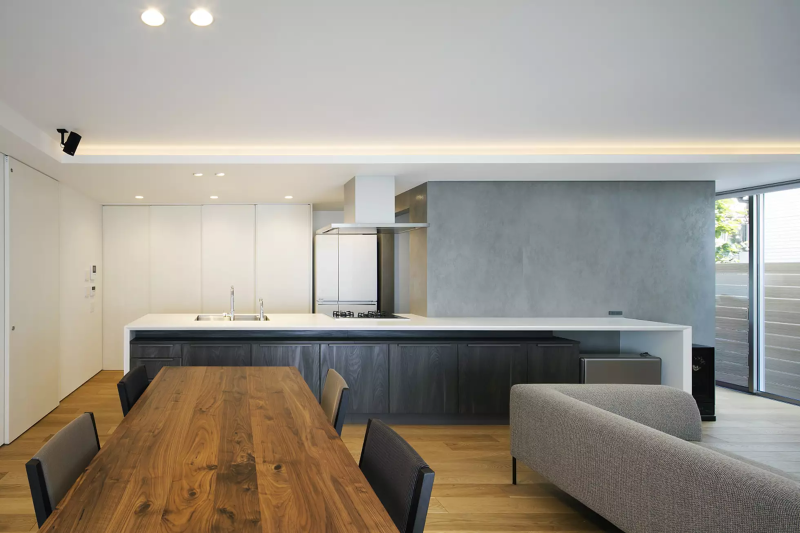 Tagged: Kitchen, White Cabinet, Light Hardwood Floor, Recessed Lighting, and Drop In Sink.  House in Mihara by Leibal