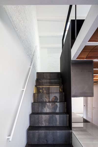 Modern home with staircase, metal tread, and metal railing. Photo 3 of La Dominique