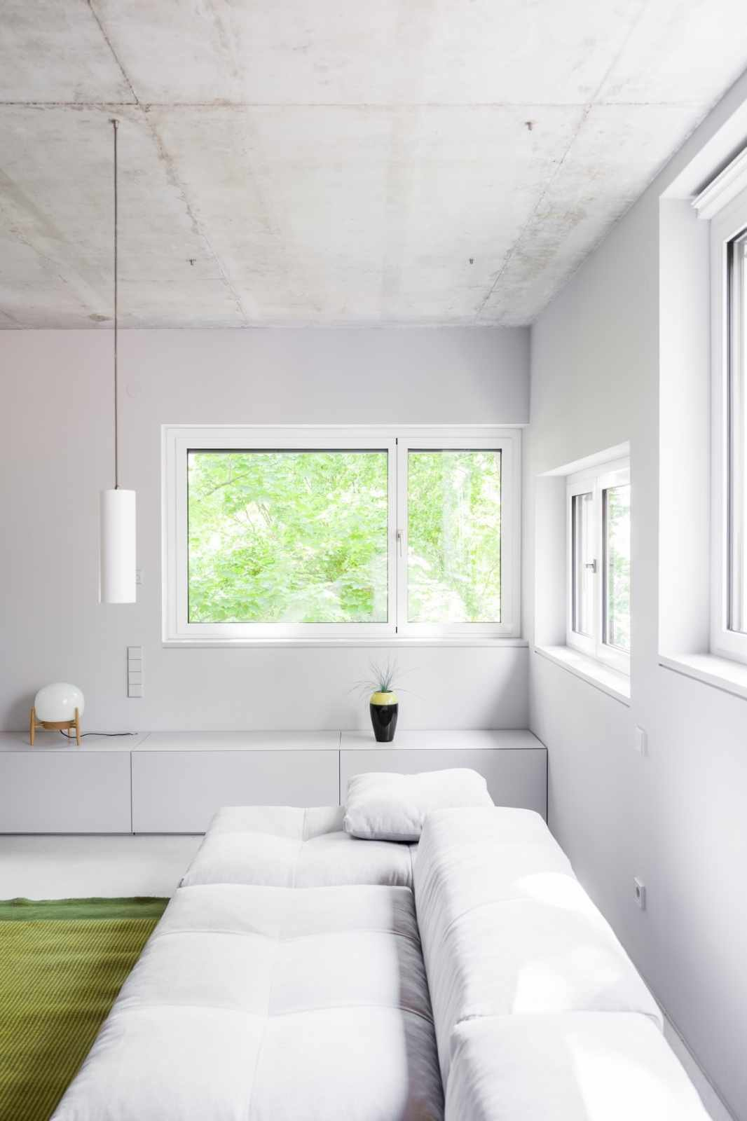 Tagged: Living Room, Sectional, and Pendant Lighting.  House on Prenzlauer Berg by Leibal