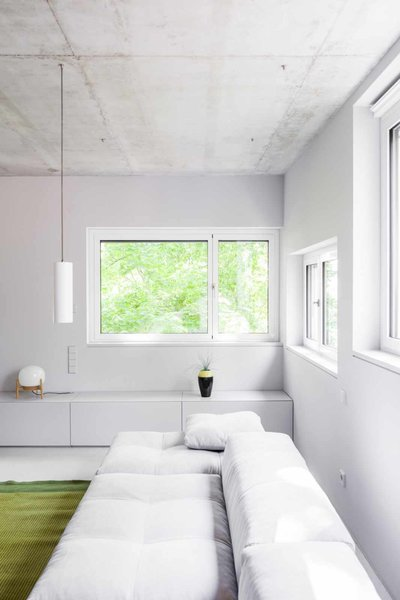 Modern home with living room, sectional, and pendant lighting. Photo 11 of House on Prenzlauer Berg