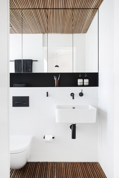 Modern home with bath room, wall mount sink, and medium hardwood floor. Photo 6 of Nano Pad
