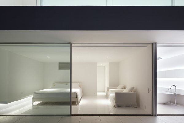 Modern home with bedroom, bed, recessed lighting, and ceramic tile floor. Photo 6 of Seaside House
