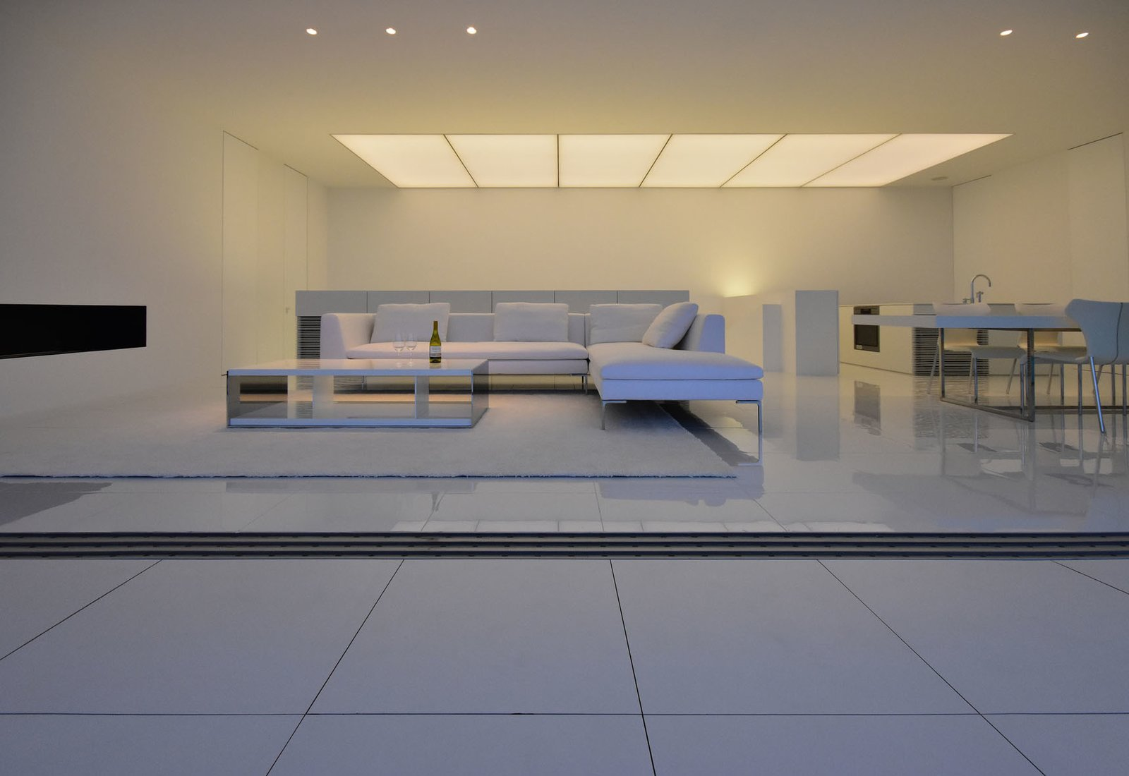 Tagged: Living Room, Sofa, Ceiling Lighting, and Porcelain Tile Floor.  Seaside House by Leibal