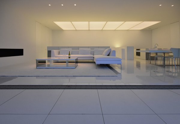 Modern home with living room, sofa, ceiling lighting, and porcelain tile floor. Photo 17 of Seaside House