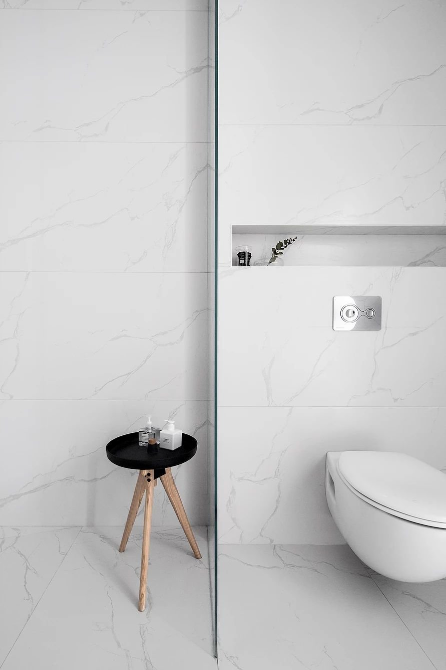Tagged: Bath Room, One Piece Toilet, Marble Wall, and Marble Floor.  S|H Apartment by Leibal