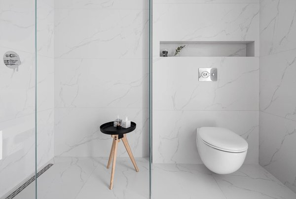 Modern home with bath room, marble floor, marble wall, and one piece toilet. Photo 5 of S|H Apartment