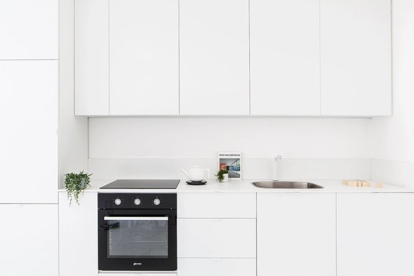 Modern home with kitchen, granite counter, and white cabinet. Photo 9 of S|H Apartment