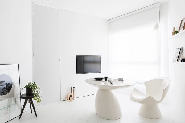 Modern home with living room, chair, and painted wood floor. Photo 15 of S|H Apartment