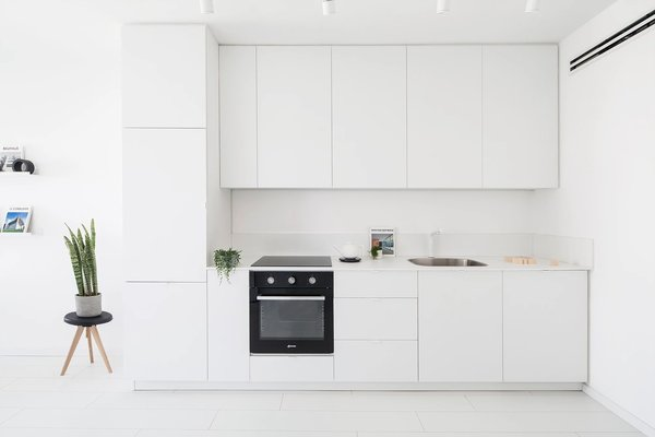 Modern home with kitchen, white cabinet, track lighting, painted wood floor, and granite counter. Photo 20 of S|H Apartment