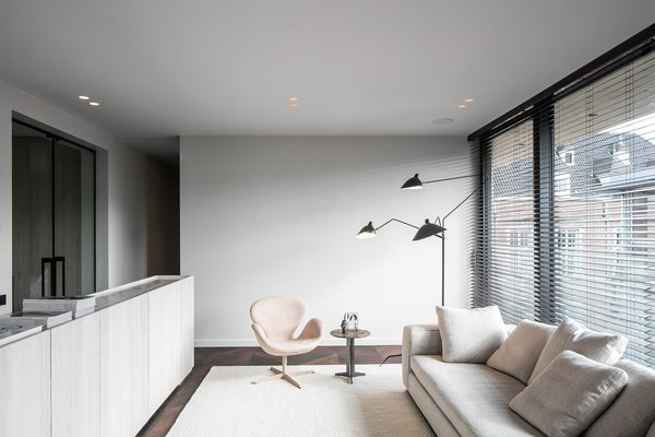 Modern home with living room, chair, dark hardwood floor, sofa, and recessed lighting. Photo 14 of Penthouse O
