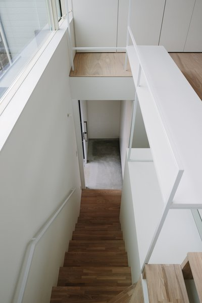 Modern home with staircase, wood tread, and metal railing. Photo 11 of Vida