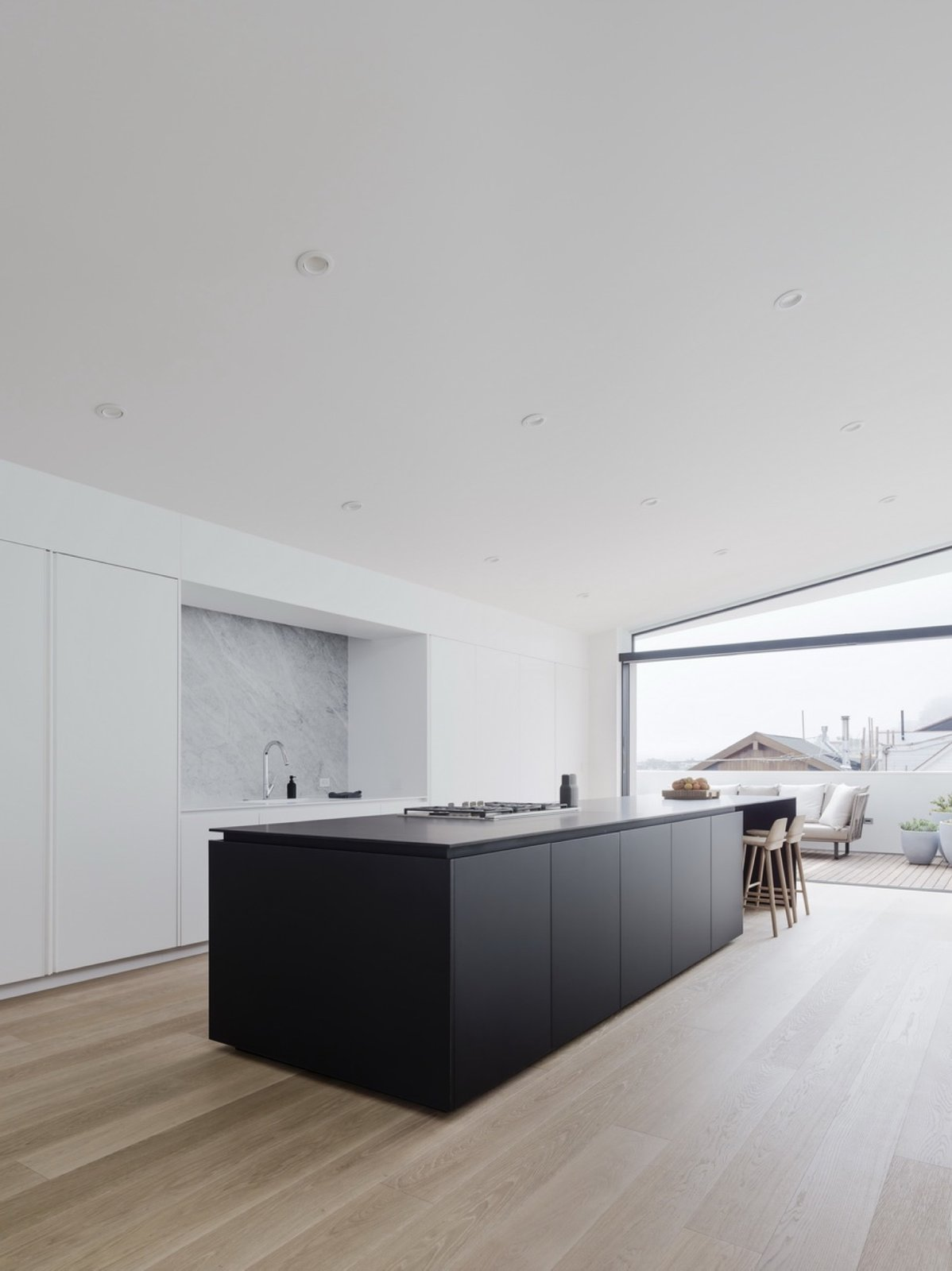 Tagged: Kitchen, Marble Backsplashe, Recessed Lighting, and Drop In Sink.  Switchback House by Leibal