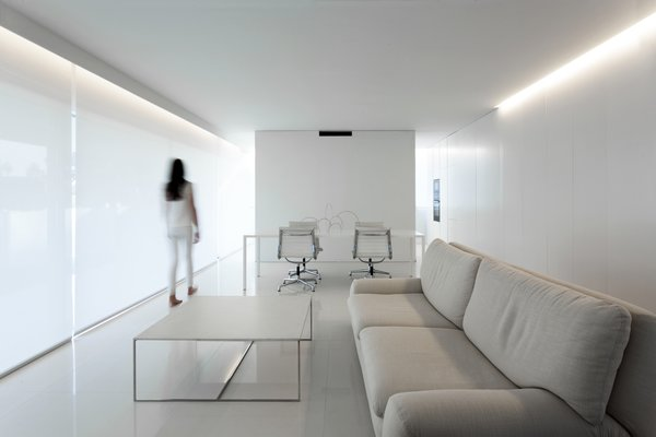 Modern home with living room, sofa, accent lighting, and porcelain tile floor. Photo 13 of Breeze House