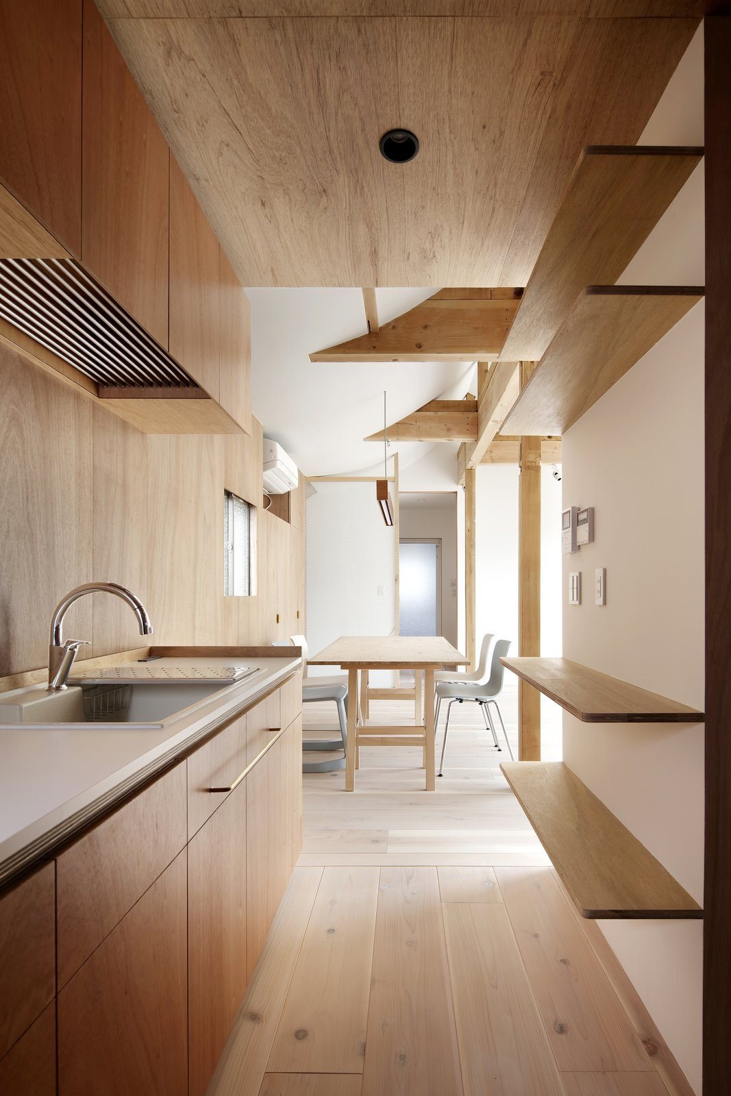 Tagged: Kitchen, Light Hardwood Floor, Recessed Lighting, and Drop In Sink. House for Four Generations by Leibal