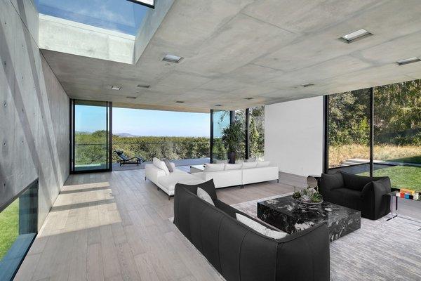 Modern home with living room, sofa, ceiling lighting, and light hardwood floor. Photo 11 of OZ Residence