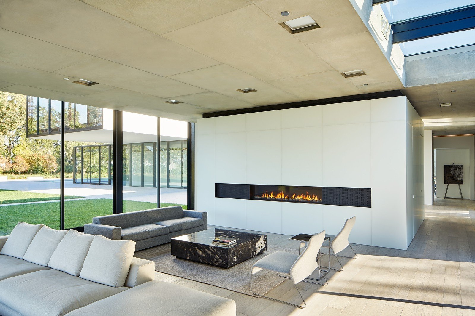 Tagged: Living Room, Gas Burning Fireplace, Ceiling Lighting, Sofa, and Light Hardwood Floor. OZ Residence by Leibal