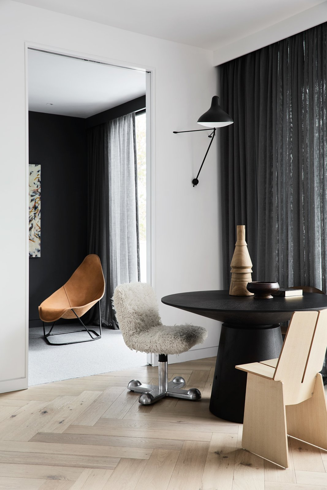 Tagged: Living Room, Chair, Light Hardwood Floor, and Wall Lighting.  South Yarra Residence by Leibal