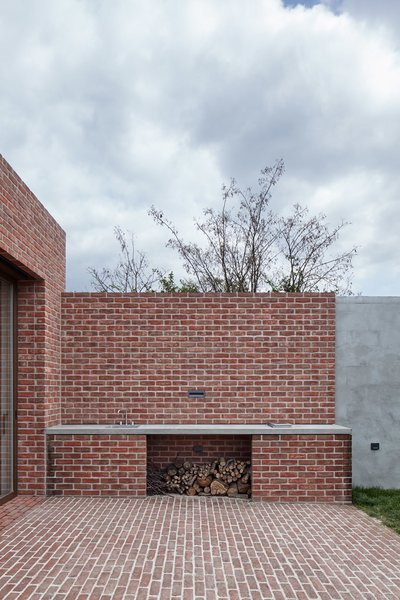 Modern home with outdoor, back yard, and small patio, porch, deck. Photo 8 of Brick Garden with Brick House