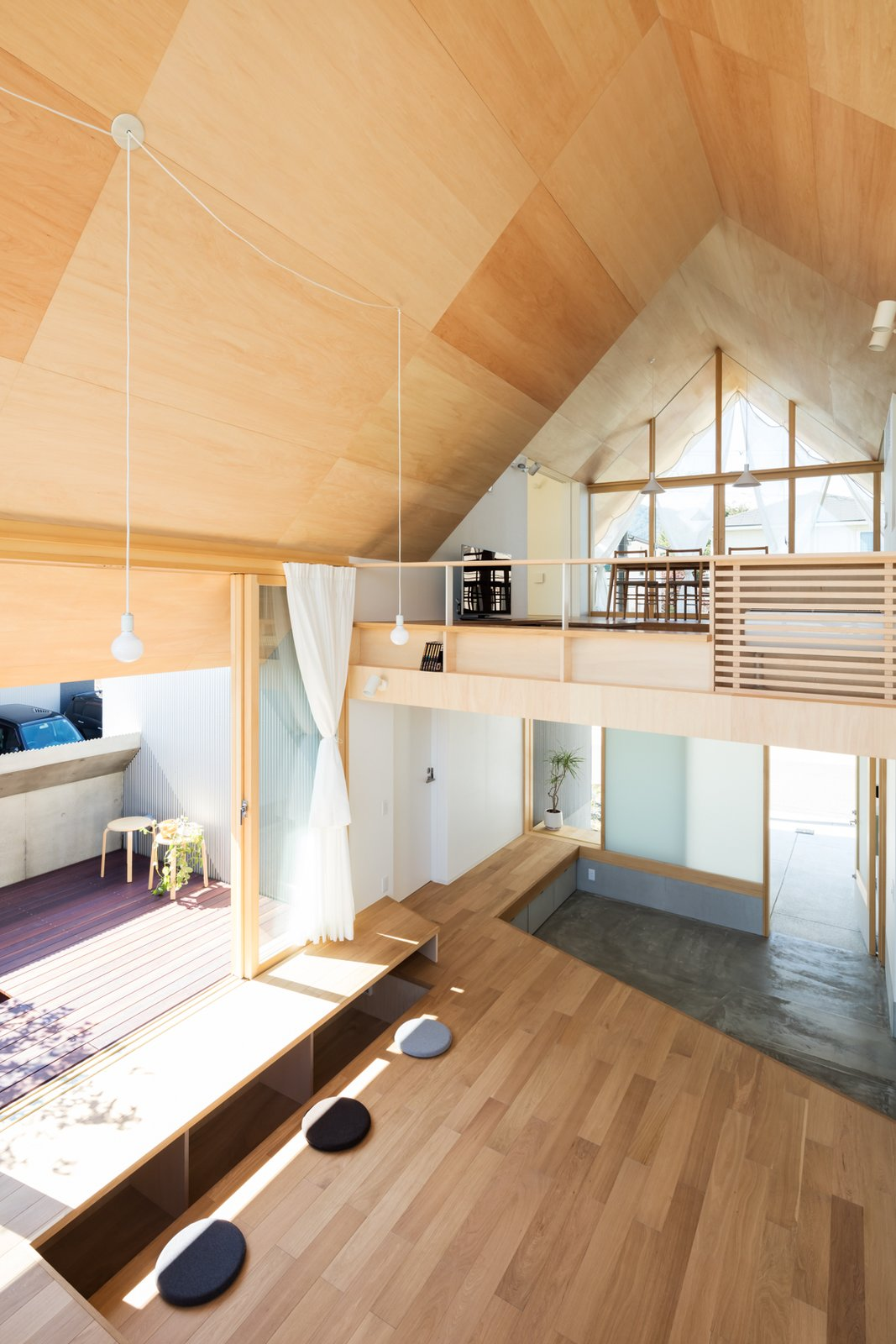 Tagged: Living Room, Pendant Lighting, and Light Hardwood Floor.  Newtown House by Leibal