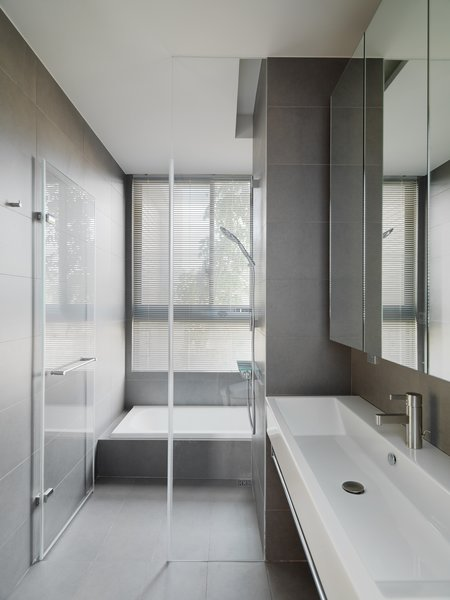 Modern home with bath room, slate floor, drop in sink, and drop in tub. Photo  of Element Apartment