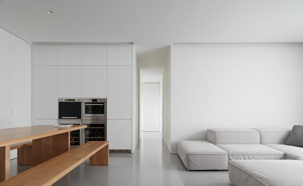 Modern home with living room, bench, sofa, and recessed lighting. Photo 11 of Element Apartment
