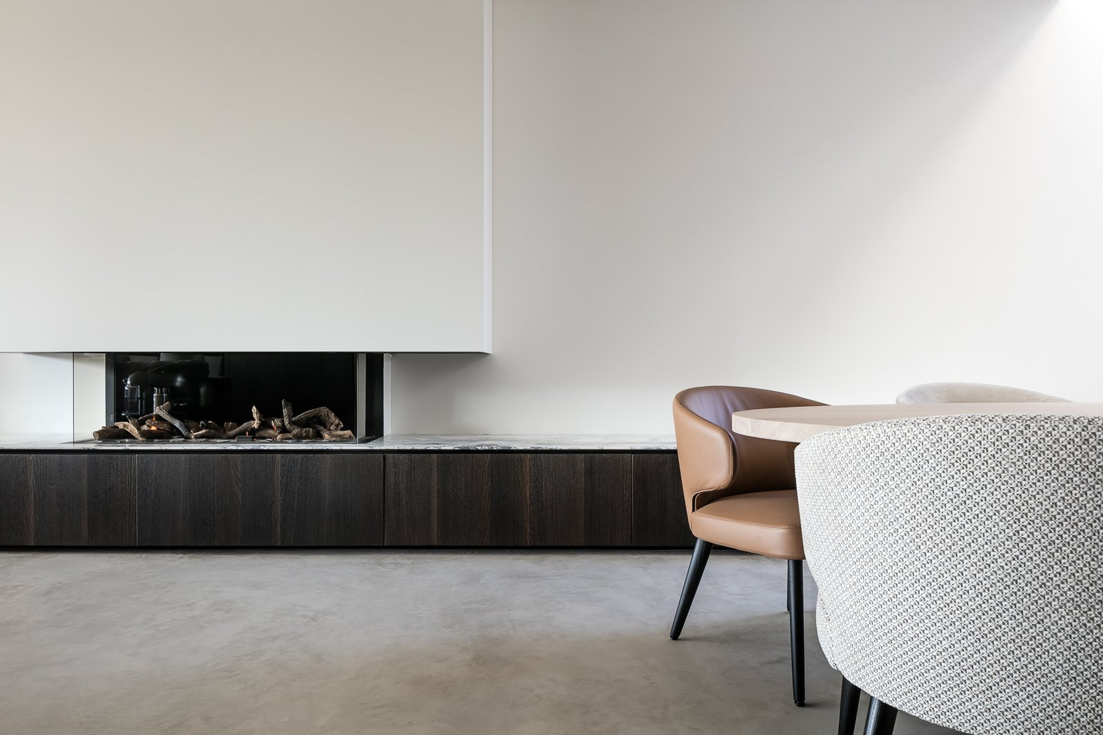 Tagged: Living Room, Standard Layout Fireplace, Concrete Floor, and Chair.  Circu House by Leibal