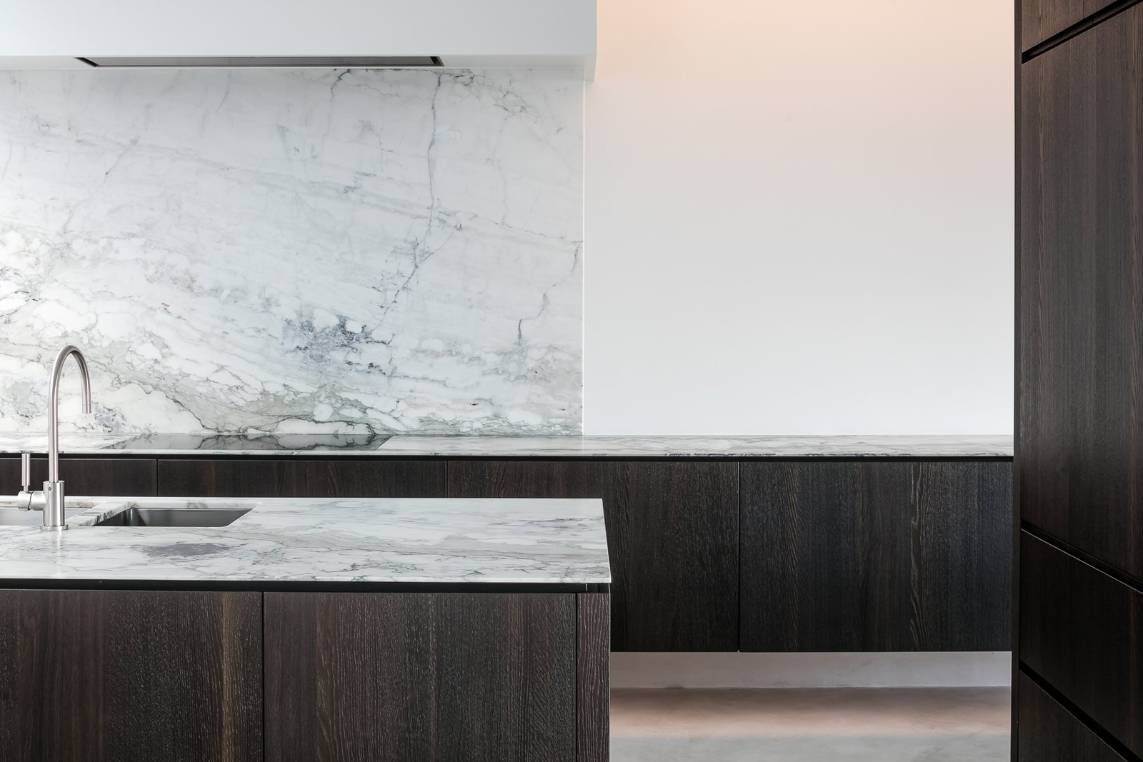 Tagged: Kitchen, Marble Counter, Marble Backsplashe, Ceiling Lighting, and Undermount Sink. Circu House by Leibal
