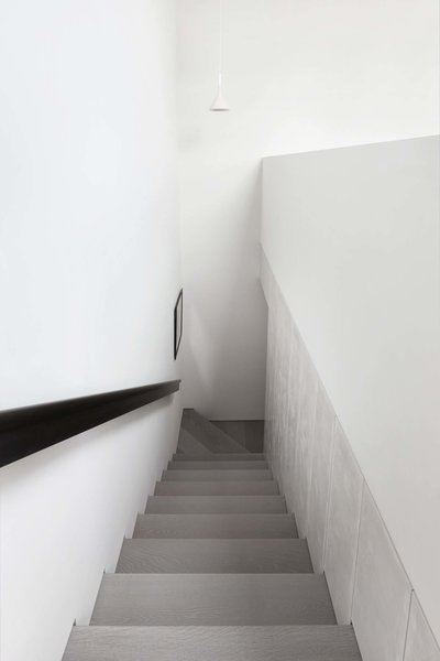 Modern home with staircase, wood tread, and wood railing. Photo 3 of Maida Vale Apartment