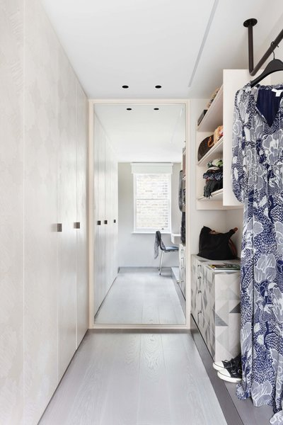 Modern home with bedroom, ceiling lighting, light hardwood floor, and chair. Photo 7 of Maida Vale Apartment